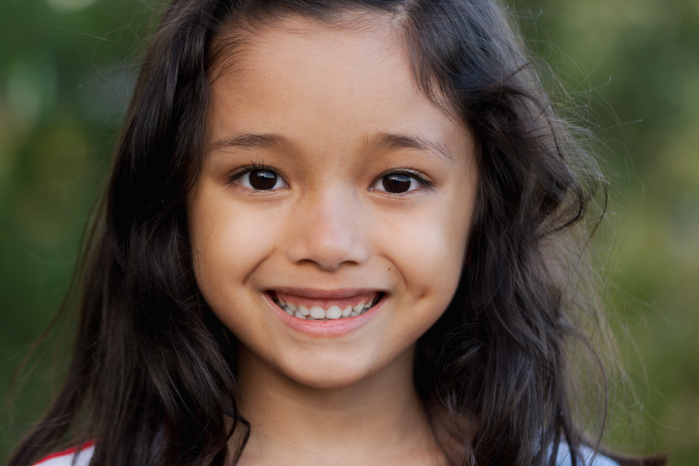 petite fille qui sourit