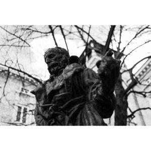 statue bronze lyon érudit